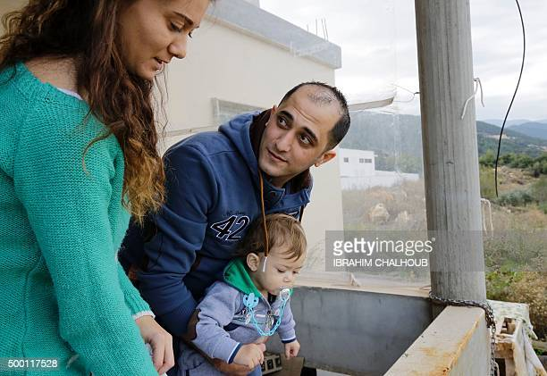 Lebanese soldier George alKhoury who was kidnapped by jihadist groups in early August 2014 in the eastern border town of Arsal stands with his wife...