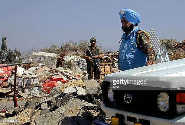 Lebanese soldier secures an area along with an Indian soldier of the UN peacekeeping troops in Tal alNahas in south Lebanon 24 August 2006 India is...