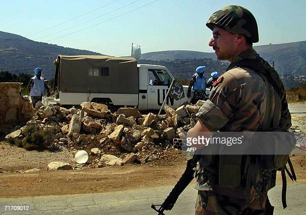 Lebanese soldier secures an area along with Indian soldiers of the UN peacekeeping troops in Tal al-Nahas in south Lebanon, 24 August 2006. India is...