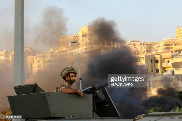 Lebanese soldier sits in an armoured vehicle as the army deploys amid clashes in the Khalde area, south of the capital, on August 1, 2021. - At least...