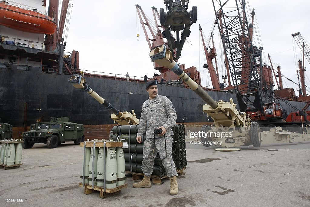 A Lebanese soldier stands next to howitzers at Beirut port upon the arrival of a shipment from the US military aid to the Lebanese army, at the Beirut port in Beirut, Lebanon, 08 February 2015. Lebanese army received an aid shipment of military equipment, weapons and ammunition worth 25 million US dollars. The shipment included over 71 M198 Howitzers and 26 million rounds of ammunition including small, medium and heavy artillery rounds.