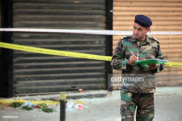 Lebanese soldier writes down a report while inspecting an area where two explosions took place at Dahieh, know as Hezbollah stronghold, South Beirut,...