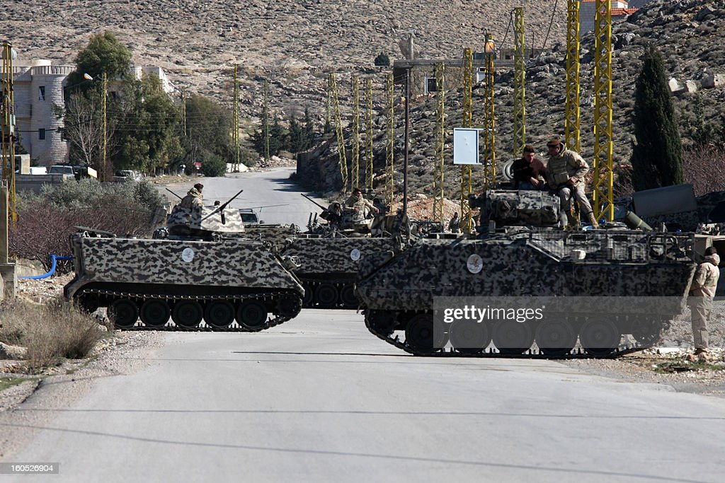 Lebanese soldiers are deployed on a road at the entrance of the village of Arsal, on the border with Syria, on February 2, 2013 a day after two soldiers were killed in a clash between gunmen and the army in the village. 'An army patrol was ambushed in Arsal as it hunted a man wanted for several terrorist acts,' the army said in a statement.