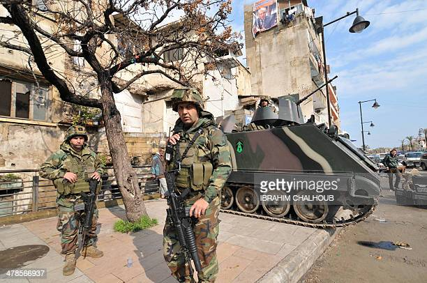 Lebanese soldiers are seen deployed on a street in the northern Lebanese city of Tripoli on March 14 2014 Two people were killed including a...