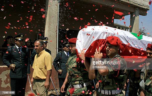 Lebanese soldiers carry the coffin of their comrade officer Galeb kalout during his funeral procession in the southern Lebanese town of Khiam 04...