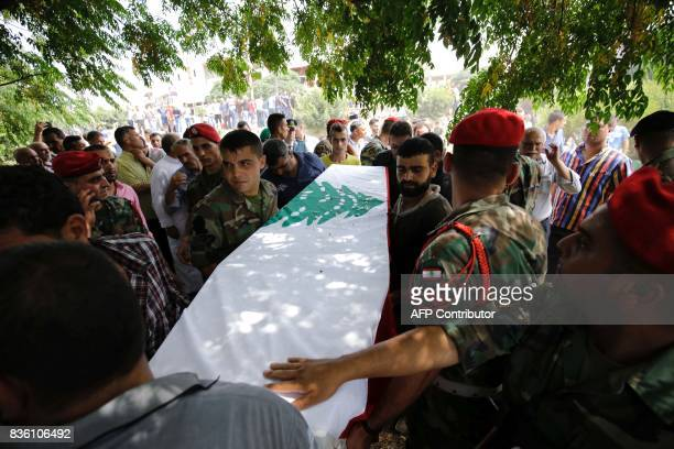Lebanese soldiers carry the coffin of their comrade Othman alShdid who died in battles against the Islamic State group along the border with Syria...