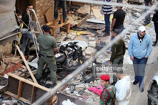 Lebanese soldiers inspect an area where two explosions took place at Dahieh know as Hezbollah stronghold South Beirut Lebanon on November 13 2015 At...