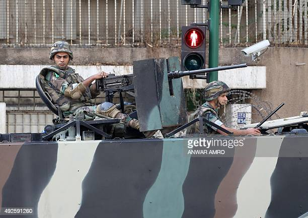Lebanese soldiers on a tank monitor the area outside the Russian embassy during a protest organised by members of the Sunni Committee of Muslim...
