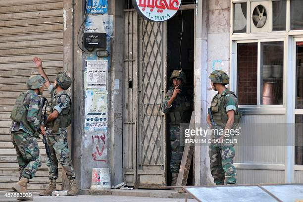 Lebanese soldiers raid an apartment in Lebanon's northern port city of Tripoli where two men suspected of syping on Lebanese military bases are...