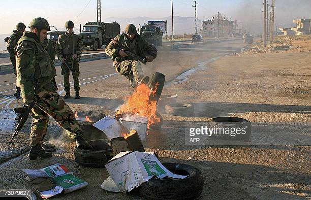 Lebanese soldiers remove a buring tire in the town of Marjayoun in south Lebanon 23 January 2007 At least two people were wounded by gunshots at dawn...