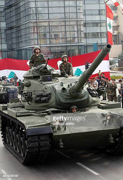 Lebanese soldiers riding a tank take part in a parade in the capital Beirut to mark Lebanon's 70th Independence Day on November 22 2013 Lebanon a...