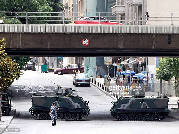 Lebanese soldiers stand guard on tanks on the fringe of a protest against the involvement of the Shiite movement Hezbollah in fighting in Syria on...
