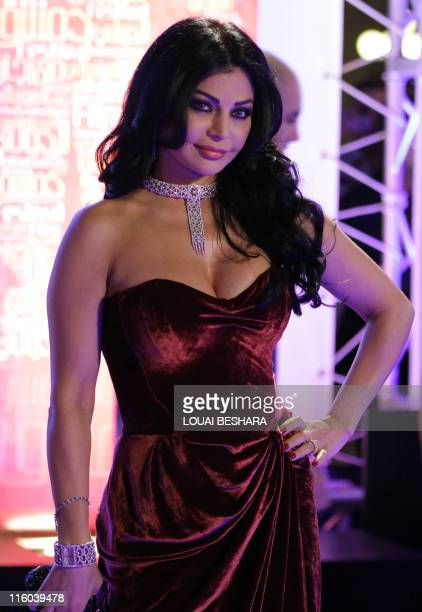 Lebanese starlet Haifa Wehbe a pop star and former model poses at the opening ceremony of the Damascus International Film Festival in the Syrian...