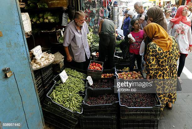 A Lebanese street vendor sells fruits and vegetables at a market in the old part of the Lebanese southern port city of Sidon south of Beirut on June...