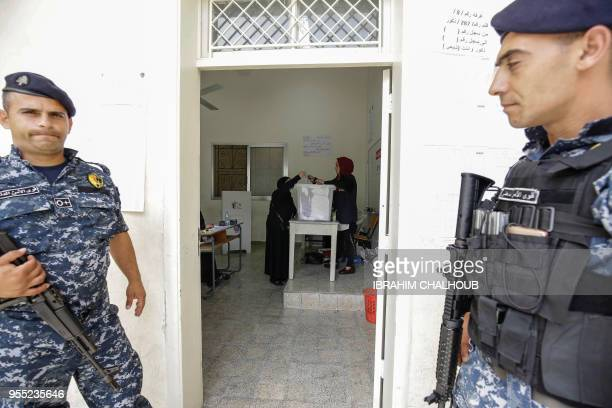 Lebanese Sunni Muslim women vote in the first parliamentary election in nine years in the northern coastal town of Qalamoun north of the capital...