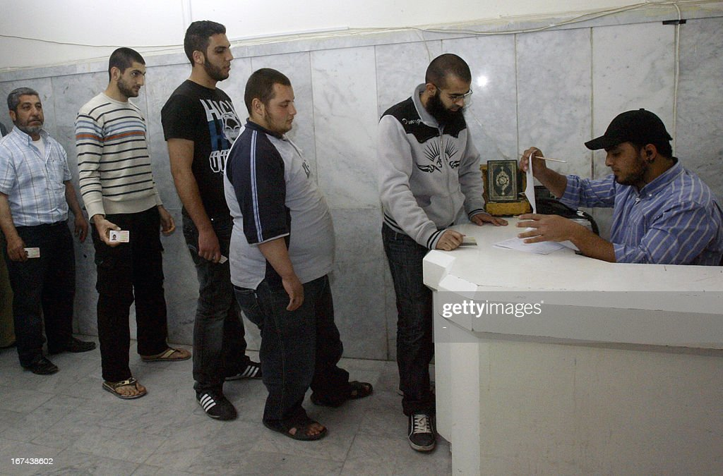 Lebanese Sunni Muslims register their names to join Syrian rebels fighting against the regime, at the headquarters of controversial Lebanese Salafist leader in the southern city of Sidon on April 25, 2013. Sheikh Ahmad al-Assir, has urged earlier this month, his followers to join Syrian rebels fighting against forces loyal to President Bashar al-Assad and the Lebanese Shiite movement Hezbollah.