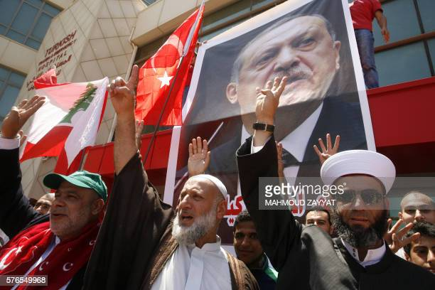 "Lebanese supporters and members of the Islamic group Jamaa Islamiya wave Turkish and Lebanese flags and flash the four finger symbol known as ""Rabaa""..."