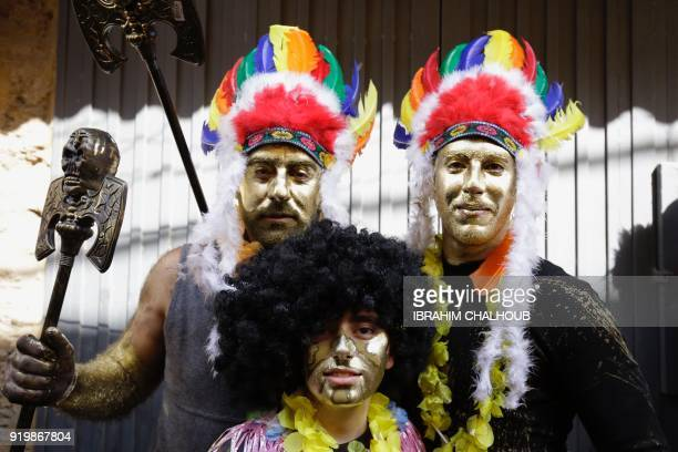 Lebanese take part in the Zambo carnival held in the northern Lebanese city of Tripoli on February 18 to mark the last period of excess on the eve of...