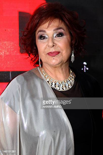 Lebanese theatre acress Nidal alAshkar poses for photographers at the 12th Murex d'Or awards ceremony in the ancient Lebanese port of Byblos north of...