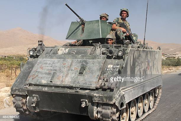 Lebanese troops deploy in the eastern town of Arsal near the Syrian border on August 28 2014 as they army clash with gunmen in the area Hundreds of...