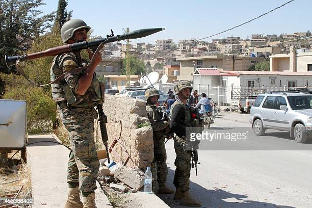 Lebanese troops stand guard in a street on August 9 2014 in the eastern Lebanese town of Arsal on the border with Syria a day after the Lebanese army...
