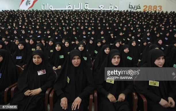 Lebanese university graduates listen to the speech of Hezbollah chief Hassan Nasrallah during a ceremony organised by the Lebanese Shiite movement to...