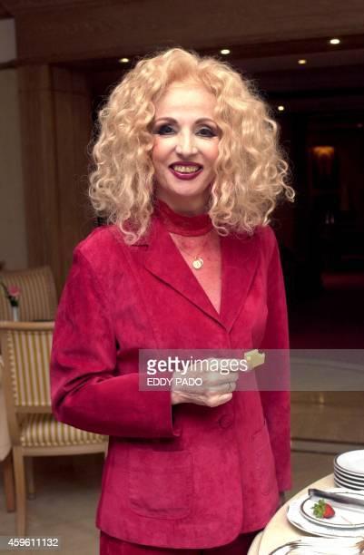 Lebanese veteran singer Sabah poses for a picture in Dubai 09 November 2002 AFP PHOTO/Eddy PADO
