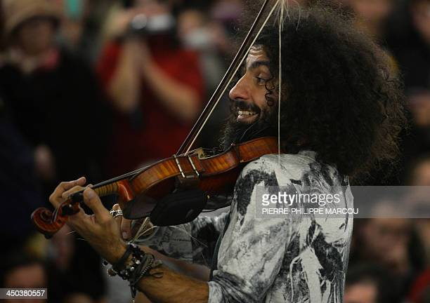 Lebanese violonist of Armenian descent Ara Malikian and the Orquesta en el Tejado perform with students of the Arturo Soria conservatory at the...