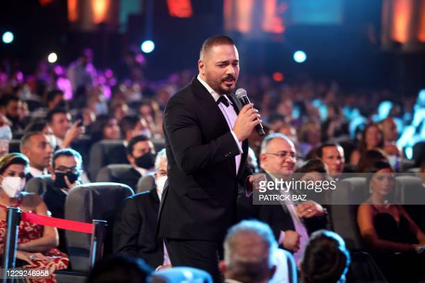 Lebanese vocalist Rami Ayash sings at the opening ceremony of the 4th edition of El Gouna Film Festival, in the Egyptian Red Sea resort of el Gouna...