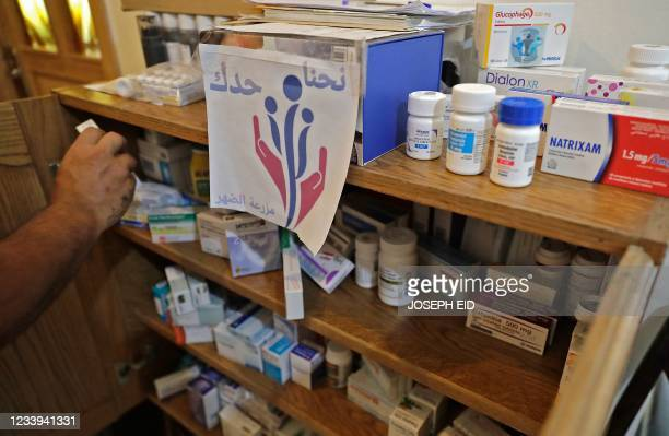 """Lebanese volunteer of the """"We Are By Your Side"""" initiative stores boxes of medications in the village of Mazraat el-Dahr in Mount Lebanon province,..."""