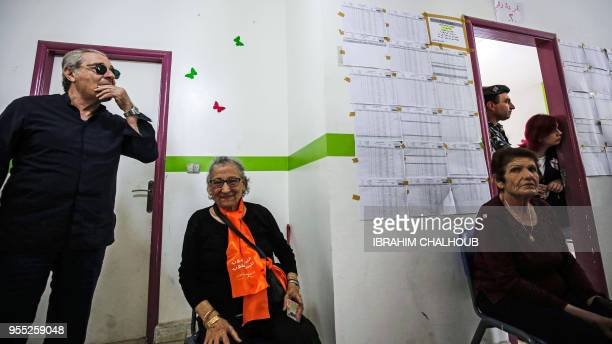 Lebanese voters wait at a polling station in the Christian coastal city of Batroun to vote in the country's first paliamentary eleciton in nine years...