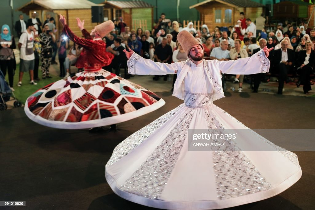 Lebanese whirling dervishes perform in a celebration during the Muslim holy month of Ramadan in the capital Beirut's Verdun street on June 8, 2017. /