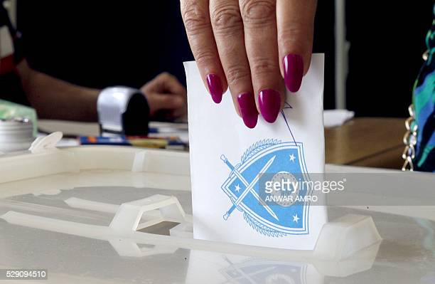 A Lebanese woman casts her vote for the municipal elections at a polling station on May 8 2016 in the capital Beirut Lebanese headed to the polls for...