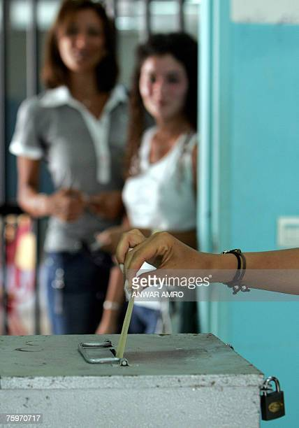 A Lebanese woman casts her vote in Beirut 05 August 2007 Voters in Lebanon cast their ballots amid tight security in crucial byelections seen as a...