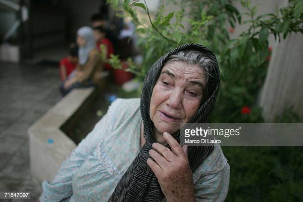 Lebanese woman cries outside Tibnin's hospital after successfully fleeing Bint Jbail July 31 2006 in Tibnin Lebanon The remaining civilian residents...