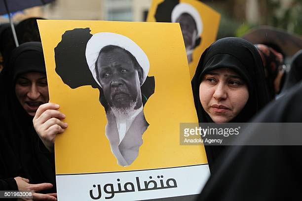 Lebanese woman holds a banner during the protest after Sheikh Ibrahim ElZakzakywho was arrested on sunday in Nigeria in Beirut Lebanon on December 19...