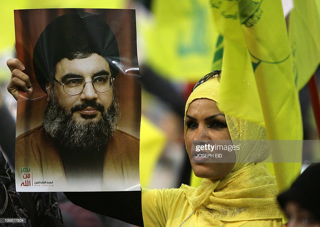 A Lebanese woman holds a picture of Hezbollah leader Hassan Nasrallah during a ceremony marking the 10th anniversary of Israel's withdrawal from southern Lebanon in southern Beirut on May 25, 2010. Nasrallah said that his militants are capable of wiping out Israel's navy and any other ships heading to Israel in the event of a new war with the Jewish state.