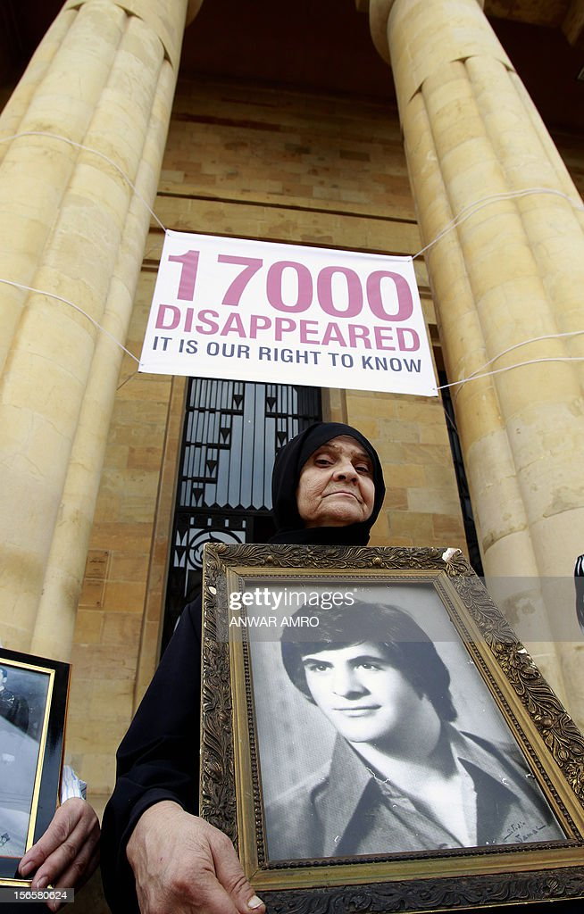 A Lebanese woman holds the image of her missing son during rally outside the National Museum which stood along the demarcation line known as the 'Green Line' marking the division between east and west Beirut on November 17, 2012. Participants marched along a route linking the Mathhaf area of Beirut, where a large number of disappearances took place, to three neighbourhoods where the state has recognised the presence of mass graves.