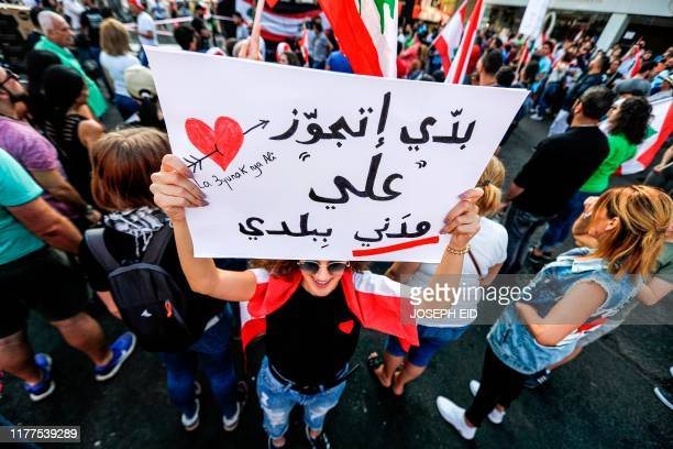 A Lebanese woman holds up a sign reading in Arabic I want to have a civil marriage with 'Ali' in my country as she attends a demonstration on the...