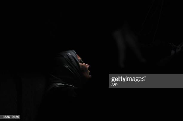 A Lebanese woman mourns during the funeral of Khodr Mustafa Alameddine who was among a group of Sunni Muslims killed by the Syrian army after they...