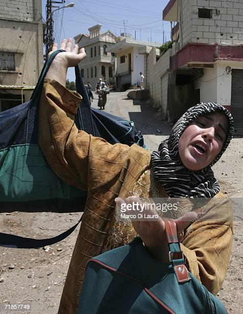 Lebanese woman tries to flee after being trapped in poor conditions as a result of the Israeli bombing campaign on August 1 2006 in the village of...