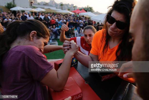 Lebanese women compete in an armwrestling championship in the coastal city of Jounieh on July 13 2018 As far back as the 19th century men in villages...