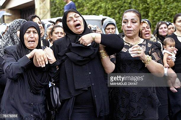 Lebanese women cry in mourning during a funeral procession for Lebanese army officer Ali Nassar in the village of Kfar Hata south of Beirut 02...