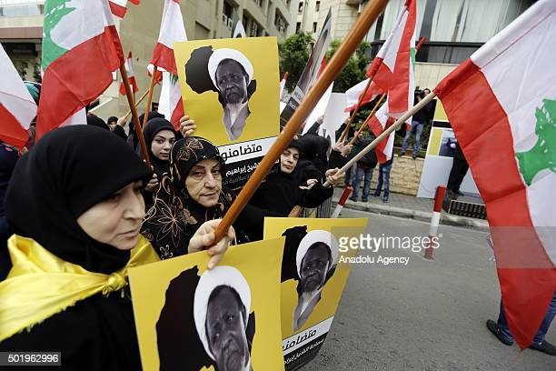 Lebanese women hold banners and flags of Lebanon during the protest after Sheikh Ibrahim ElZakzakywho was arrested on sunday in Nigeria in Beirut...