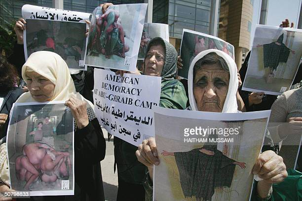 Lebanese women hold up 04 May 2004 copies of the released photos showing US troops humiliating Iraqi prisoners in Abu Gharib jail a former dreaded...