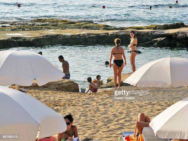 Lebanese women in bikinis at hit the beach in Lazy Bee beach resort on the outskirts of Beirut towards Sidon on August 17 2008 After the dispute...
