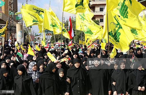 Lebanese women loyal to Hezbollah demonstrate in the village of Kfar Kila near the LebaneseIsraeli border in south Lebanon to mark AlQuds day during...