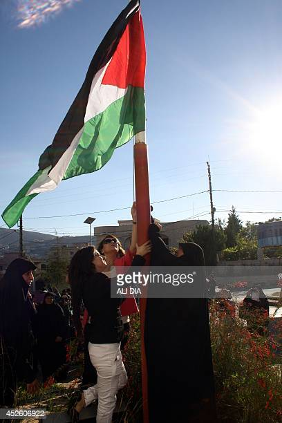 Lebanese women raise the Palestinian flag during a demonstration in support of the inhabitants of the Gaza Strip and to mark the annual Quds Day...