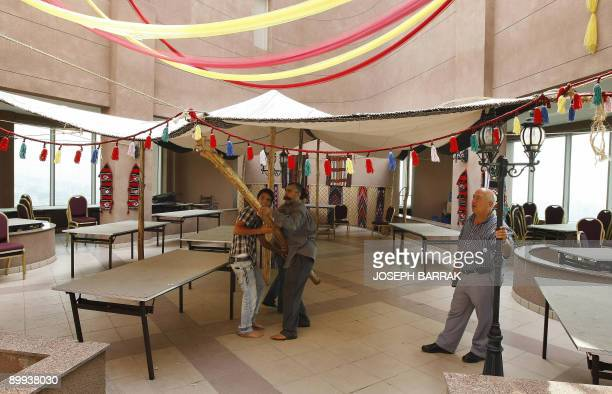 Lebanese workers erect an Arabic style tent inside the lobby of a hotel in Beirut as they prepare for the Muslim holy fasting month of Ramadan on...
