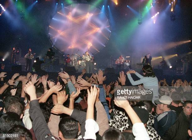 Lebanese youths dance to the rhythms of Egyptian pop star Amr Diab in Beirut early 01 January 2000 as Lebanese welcome the new millennium The Beirut...